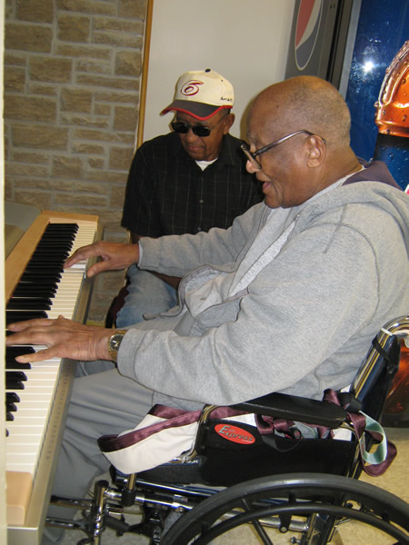 Cameron Veterans Home veteran playing the piano