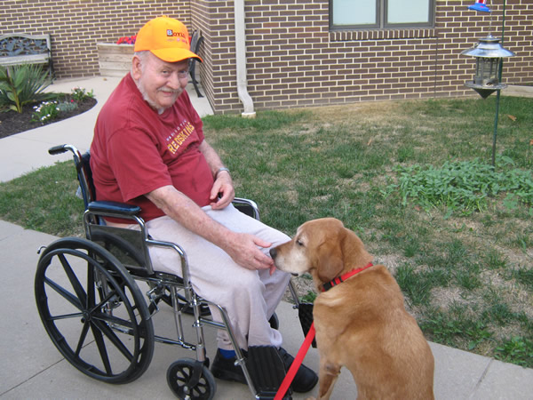 Cameron Veterans Home veteran petting a dog